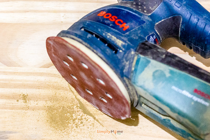 Sanding with a 200-grit sanding paper